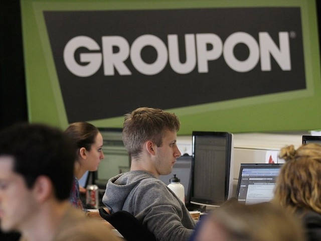 Groupon is reportedly weighing an acquisition of Yelp as pressure from frustrated investors mounts