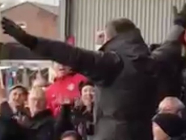 Manchester United captain Michael Carrick enjoys victory over Burnley in away end, and leads the singing