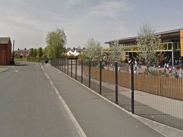 Security guard threatened with weapon during cash-in-transit robbery outside school