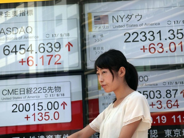 Asian stocks steady after Wall Street notches record highs, dollar holds firm