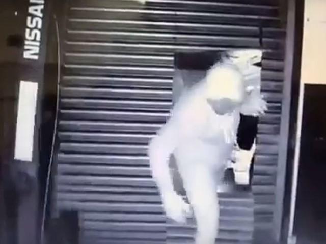 WATCH: Gang raid Milnsbridge e-cig business after cutting man-sized hole through shutters