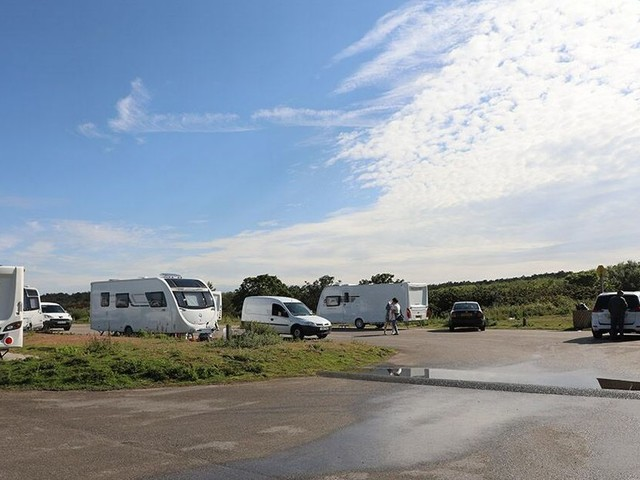 Travellers set up camp at one of Merseyside's most popular beaches