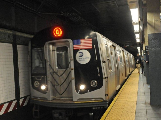 Q train delayed for hours due to burning wires above tracks