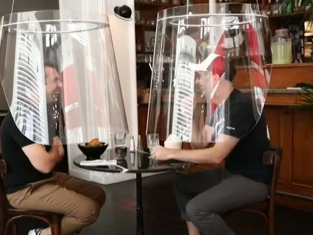 As plexiglass barriers become the future of indoor dining, experts worry they may not be enough