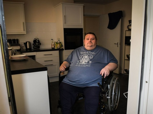 Disabled man weighing 28 stone wants housing company to widen door to access his garden