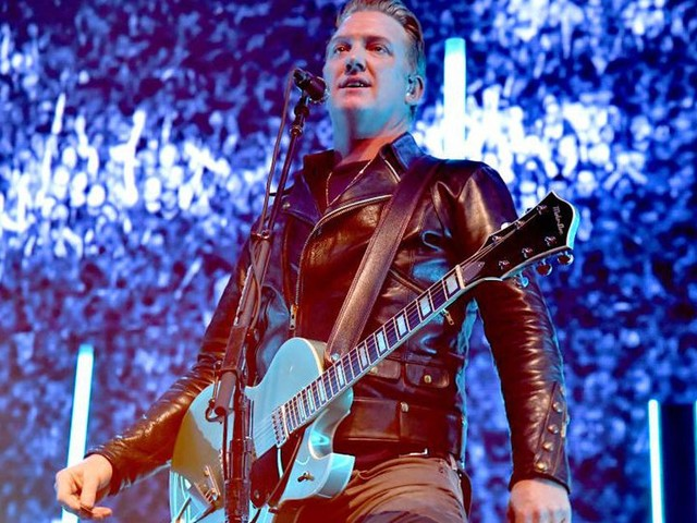 Josh Homme apologises after photographer said he kicked her