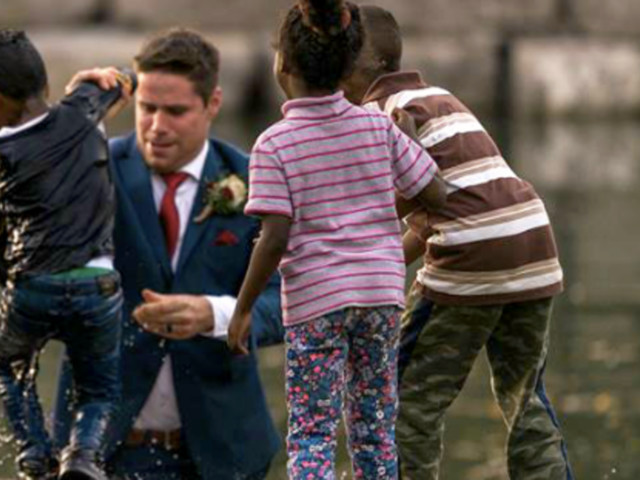 Groom Heroically Saves Drowning Boy During Wedding Photo Shoot