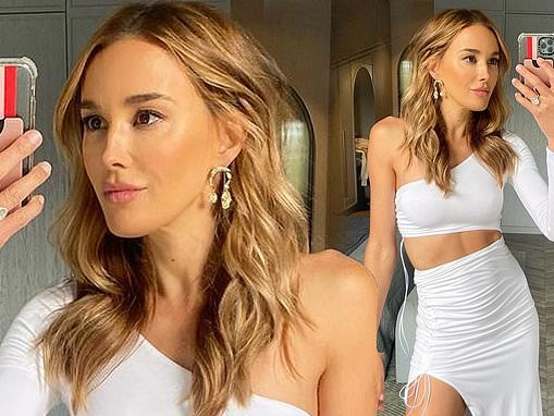 Rebecca Judd shows off her figure and gives a glimpse of her washboard abs in $440 outfit