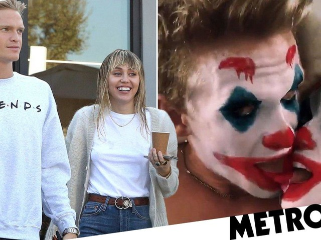 Miley Cyrus and Cody Simpson lock lips in bed wearing Joker filter masks and it's all kinds of weird