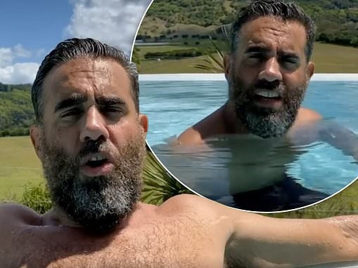 Bearded Bobby Cannavale goes shirtless as he relaxes in an infinity pool