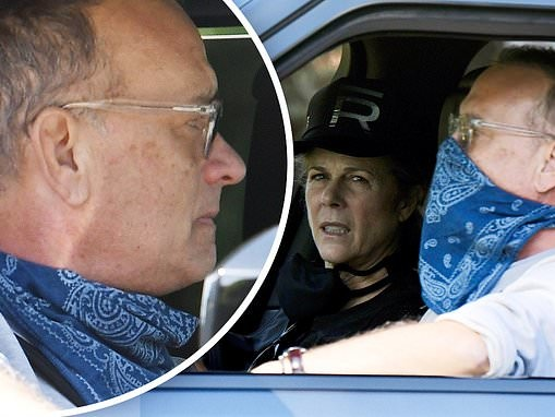 Tom Hanks covers face with bandanna as he and Rita Wilson enjoy LA drive