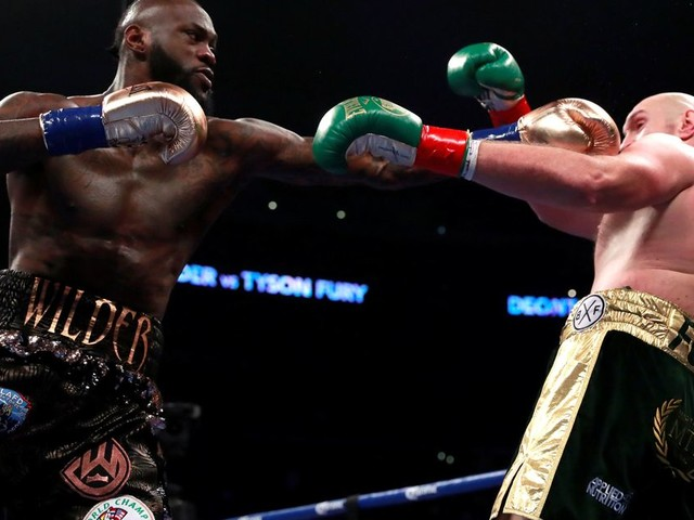 Tyson Fury vs Deontay Wilder ends in controversial draw after Brit was dropped twice