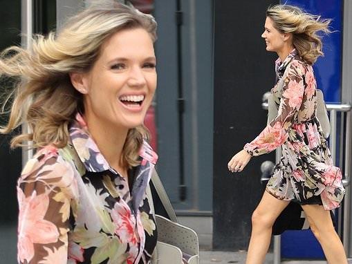 Charlotte Hawkins puts on a leggy display in a floral mini dress as she arrives at Global Studios