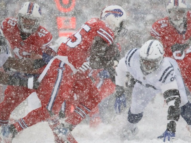 Bills and Colts play in a whiteout after snow takes over Buffalo stadium — and fans can barely see the field