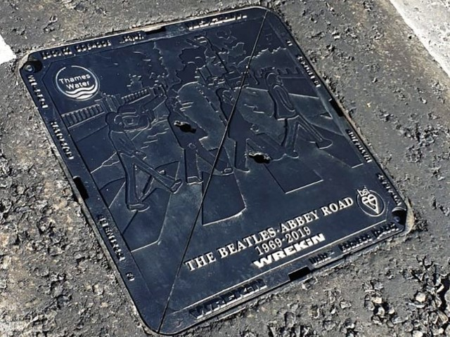Beatles themed manhole cover for Abbey Road