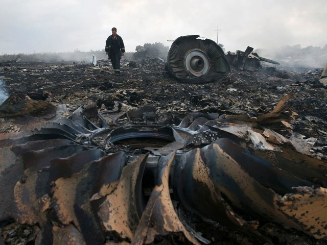 MH17 investigators charge three Russians and one Ukrainian with murder over shooting down of Malaysia Airlines jet that killed 298