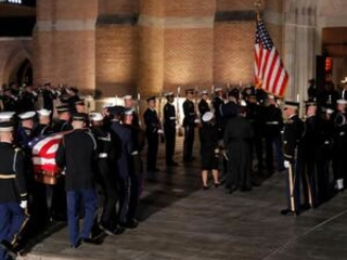 The Latest: Bush's body to lie in repose all night at church
