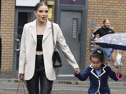 Helen Flanagan shows off her taut midriff in a black crop-top and matching slacks