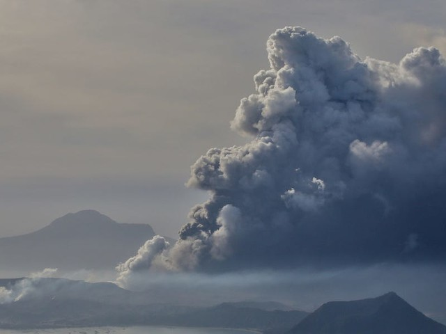 Stunning photos show a huge volcanic eruption in the Philippines spewing smoke and ash into the sky, as experts warn of a possible tsunami