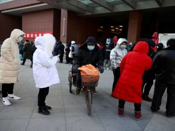 China sees spike in coronavirus cases ahead of WHO team visit to probe COVID-19 origins