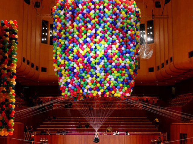 Artist Gets Lifted Off The Ground By 20,000 Balloons In Performance About The Fear Of Happiness