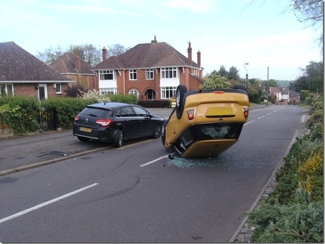 PICTURES: Mini flips over and lands on roof in residential street