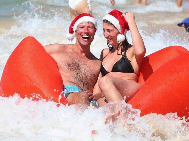 Australians are playing through a record-breaking Christmas heat wave