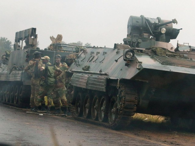Zimbabwe ruling party accuses army chief of treason as tanks seen near capital