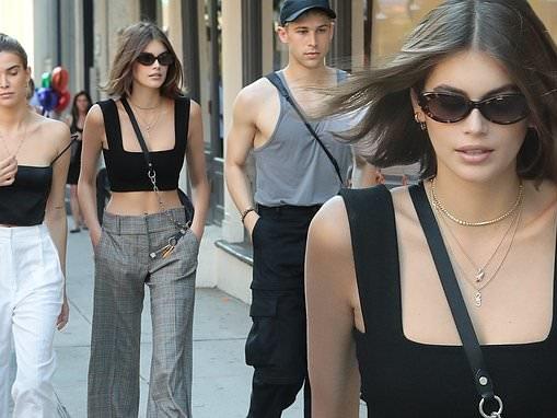 Kaia Gerber shows off her fashion sense in a crop top and plaid slacks