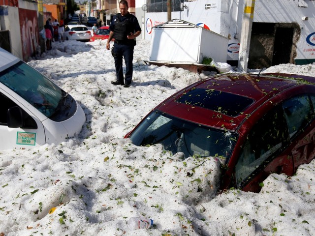 Hail leaves six feet of ice as temperatures hit 27C