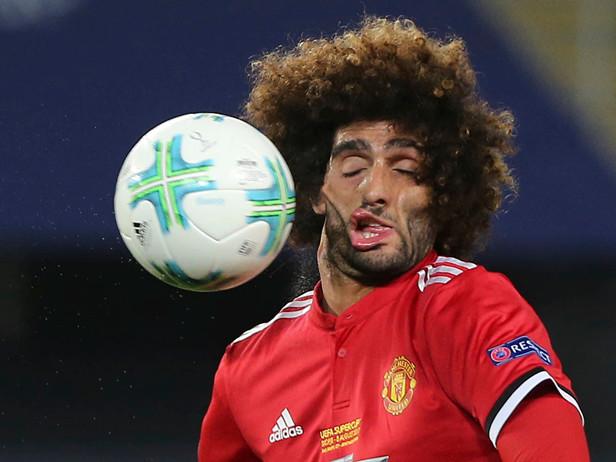 Man Utd: Harrowing Image Of Marouane Fellaini 'Face Melt' Mishap Immortalised By Australian Street Artist (Photo)