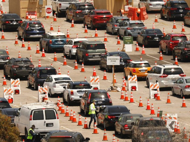 Coronavirus testing sites across the US are overwhelmed. Aerial photos of long drive-thru lines in Texas, California, and Virginia show what that looks like.