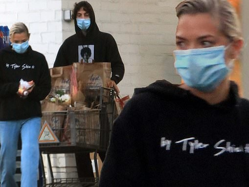 Jaime King keeps cozy in a black hoodie as she loads up on groceries and bouquets with a mystery man