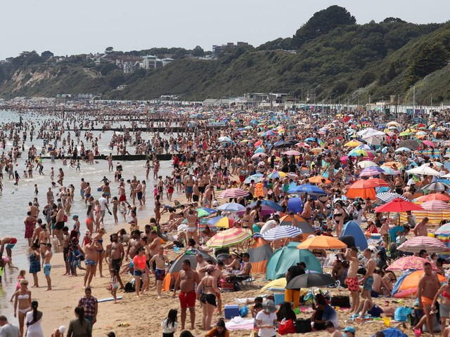 Packed beaches and traffic jams as thousands flock to the coast amid heatwave