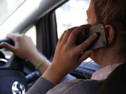 Millions still using mobile phones while driving, research suggests