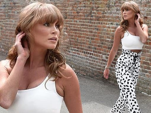 Summer Monteys-Fullam teases a glimpse of her taut midriff in crop-top