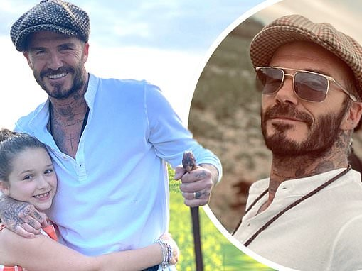 David Beckham cuddles daughter Harper during bank holiday stroll