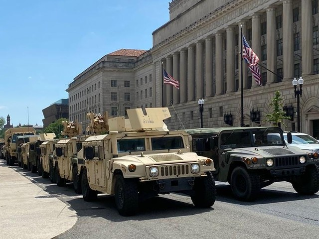 Protesters say the nation's capital 'feels like it's turning into a military state' as National Guard and unidentified troops patrol the streets at Trump's command