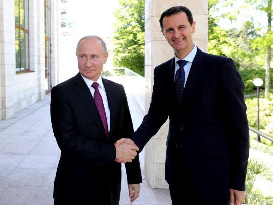 Putin meets Assad, calls for 'political process' on Syria