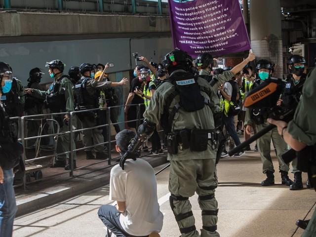 Reaction: China warns Britain against 'opening doors' to Hongkongers