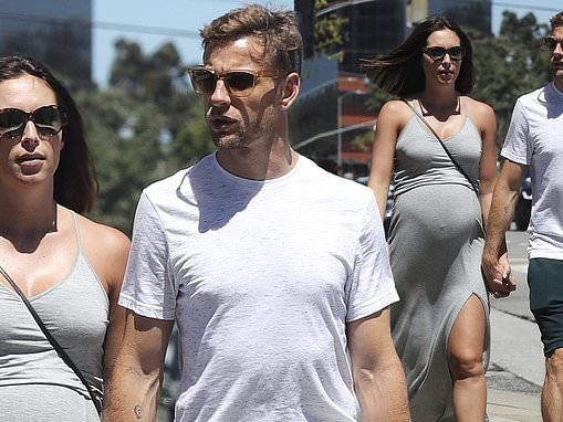 Jenson Button's pregnant fiancée Brittny Ward keeps cool in a grey maxi dress on sunny stroll