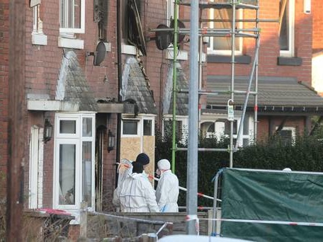 Man and woman charged over house fire that killed three children