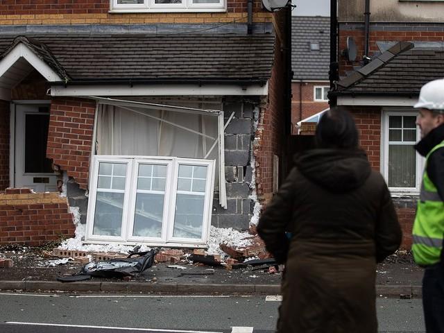'Stolen' car smashes into house near Manchester Fort Shopping Centre