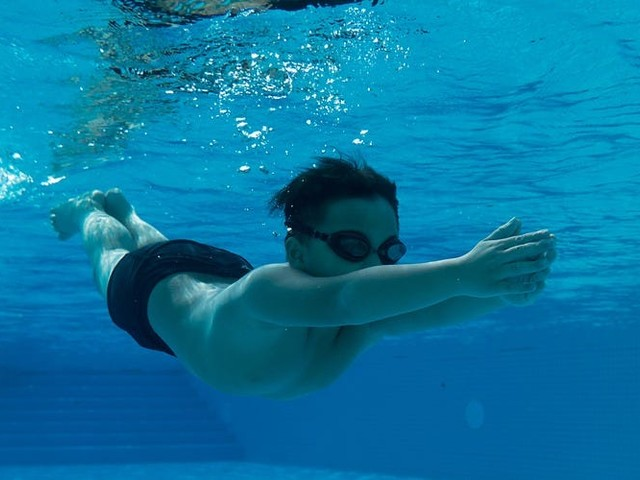 It's pretty safe to swim in a pool during the coronavirus pandemic. Just avoid the locker room and keep moving.