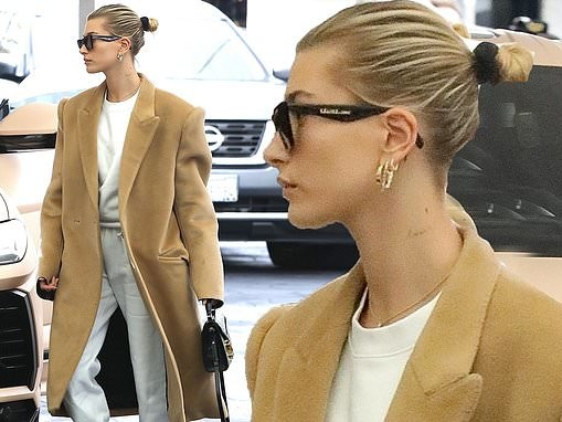Hailey Bieber rocks her favorite comfy combo of taupe men's style coat and lounge outfit