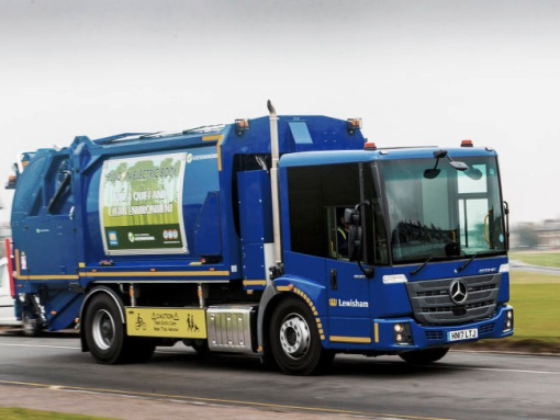 Mercedes-Benz Econic compresses refuse with electric tipper body