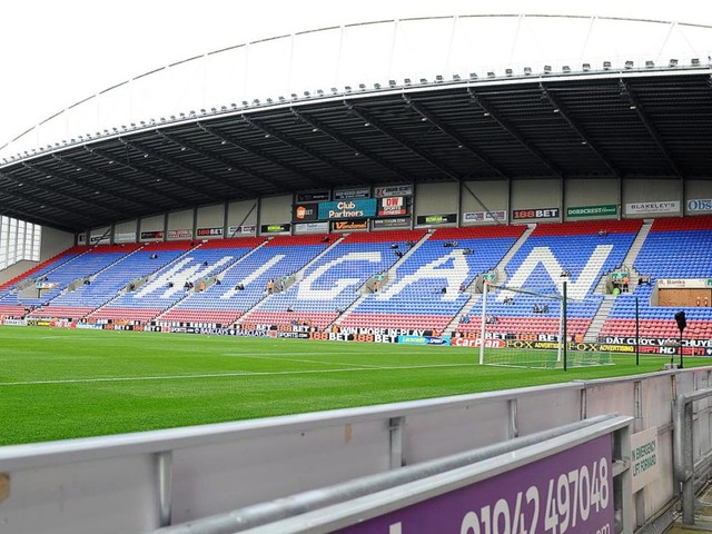 Wigan in fight to finish season with ten investors showing interest and squad to go without pay amid administration