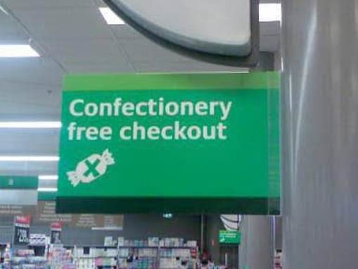 Woolworths shopper discovers a confectionery free checkout sign - and parents can't get enough of it