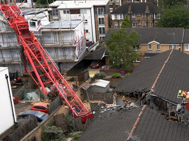 London crane collapse: One dead and four injured after 65 foot crane falls onto homes in Bow