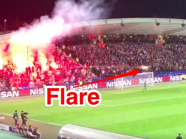 Russian football fans fired a flare at a Champions League match referee in the middle of a game